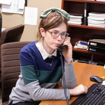 HHCI intern answering Behavioral and Mental Health referral line helping a person connect to mental health resources