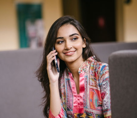 photo-of-smiling-woman-talking-on-phone